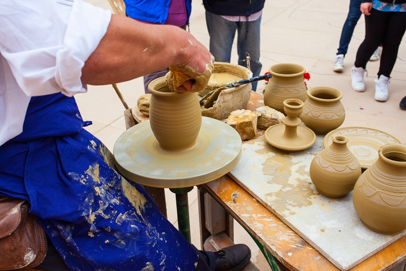 bigstock-Making-Clay-Pot-92652890