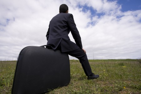 Businessman_Sit_In_His_Baggage